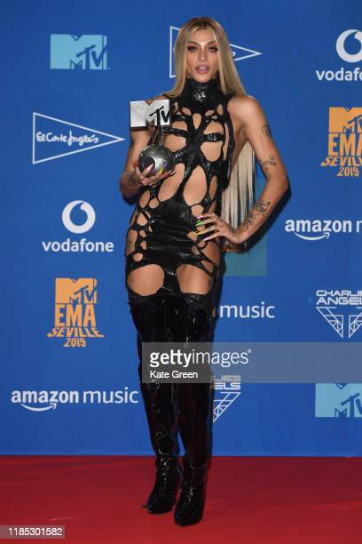 Pabllo Vittar poses with the Best Brazilian Music Award in the winners room during the MTV EMAs 2019 at FIBES Conference and Exhibition Centre on...