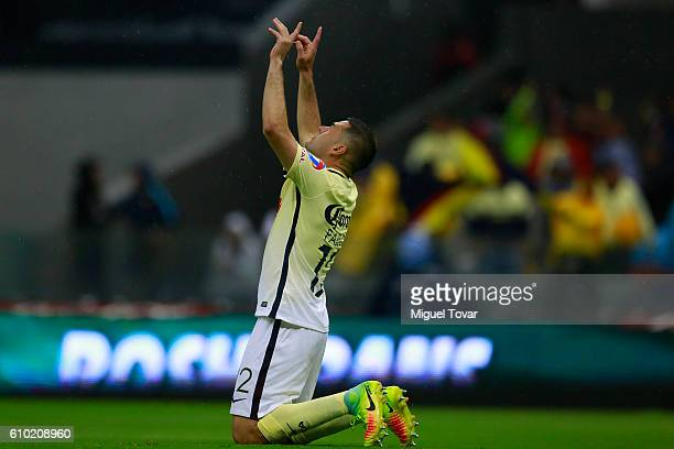 Pablo Aguilar of America celebrates after scoring the first goal of his team during the 11th round match between America and Pumas UNAM as part of...