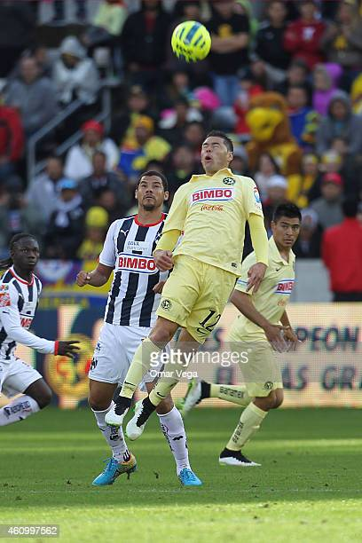 Pablo Aguilar of America jumps for a header during a friendly match between America and Monterrey at BBVA Compass Stadium on January 03 2015 in...