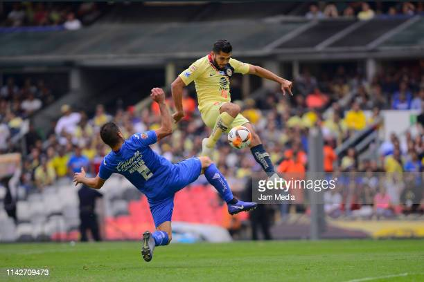 Pablo Aguilar of Cruz Azul and Henry Martin of America fight for the ball during the 14th round match between America and Cruz Azul as part of the...