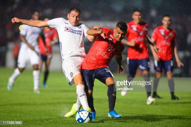 Pablo Aguilar of Cruz Azul fights for the ball with Carlos Gutierrez of Veracruz during the 9th round match between Veracruz and Cruz Azul as part of...
