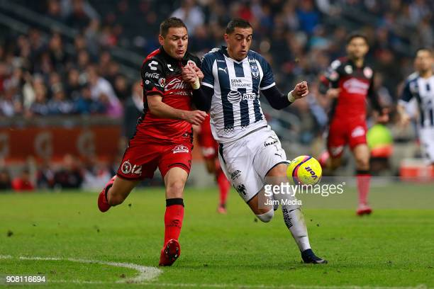 Pablo Aguilar of Tijuana and Leonel Vangioni of Monterrey fight for the ball during the third round match between Monterrey and Tijuana as part of...