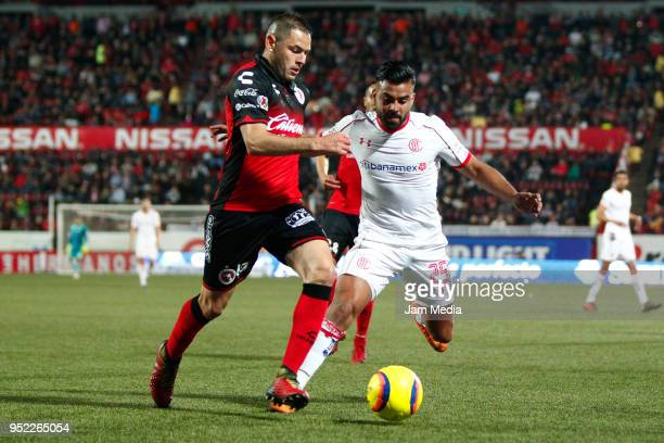 Pablo Aguilar of Tijuana and Pedro Canelo of Toluca fight for the ball during the 17th round match between Tijuana and Toluca as part of the Torneo...