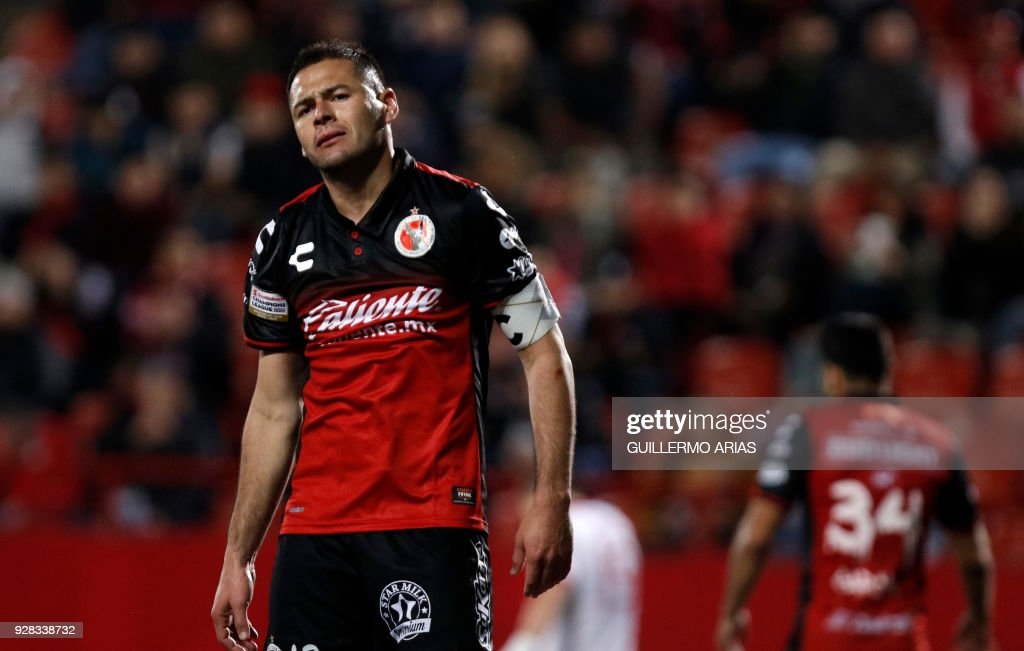Pablo Aguilar of Tijuana from Mexico reacts after missing a shot against New York from United States, during the first leg of the CONCACAF Champions League quarterfinals match at Caliente Stadium in Tijuana, Mexico on March 6, 2018. /