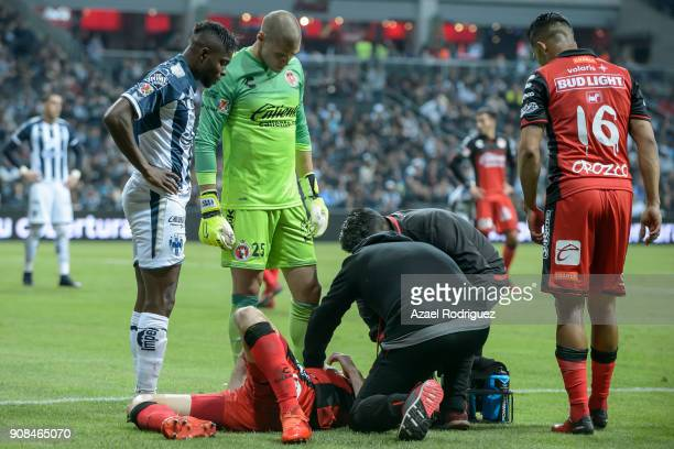 Pablo Aguilar of Tijuana gets medical aid during the third round match between Monterrey and Tijuana as part of Torneo Clausura 2018 Liga MX at BBVA...