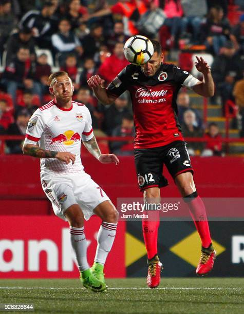 Pablo Aguilar of Tijuana heads the ball during the quarter finals first leg match between Tijuana and New York RB at Caliente Stadium on March 06...