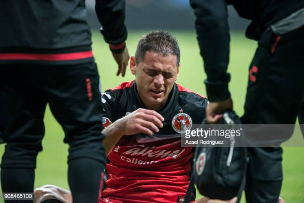 Pablo Aguilar of Tijuana receives medical aid after being injured during the third round match between Monterrey and Tijuana as part of Torneo...