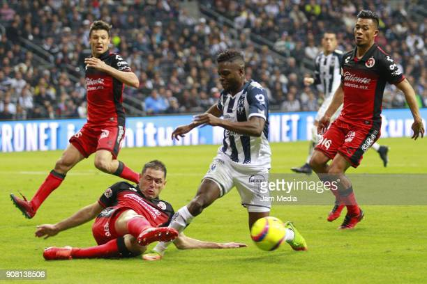 Pablo Aguilar of Tijuana slides for the ball against Aviles Hurtado of Monterrey during the third round match between Monterrey and Tijuana as part...