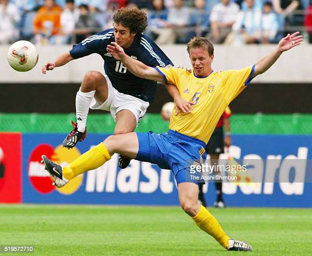 Pablo Aimar of Argentina and Tobias Linderoth of Sweden compete for the ball during the FIFA World Cup Korea/Japan Group F match between Sweden and...