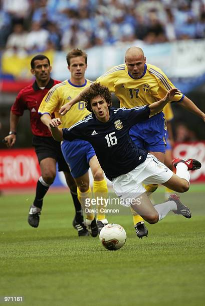Pablo Aimar of Argentina is brought down by Magnus Svensson of Sweden during the Argentina v Sweden Group F World Cup Group Stage match played at the...