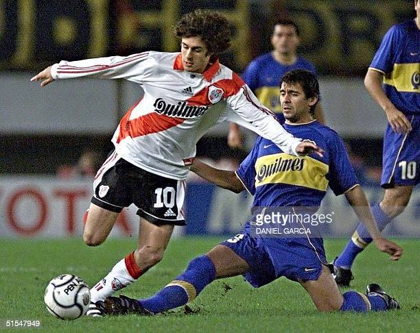 Pablo Aimar of River Plate takes the ball from Cristian Traverso of Boca Juniors 17 May 2000 during their first quarterfinal games of the Copa...