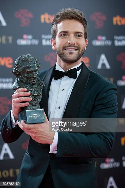 Pablo Alboran holds the award for best original song during the 30th edition of the Goya Cinema Awards at Madrid Marriott Auditorium on February 6...