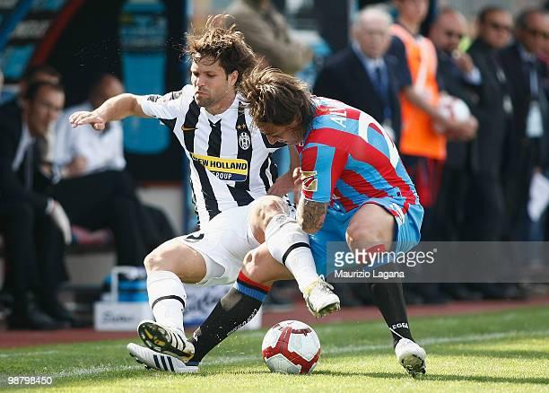 Pablo Alvarez of Catania Calcio competes for the ball with Diego Ribas da Cunha of Juventus FC during the Serie A match between Catania and Juventus...