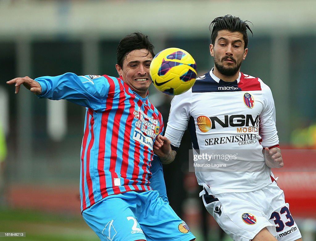 Pablo Alvarez (L) of Catania competes for the ball with Panagiotis Kone of Bologna during the Serie A match between Calcio Catania and Bologna FC at Stadio Angelo Massimino on February 17, 2013 in Catania, Italy.