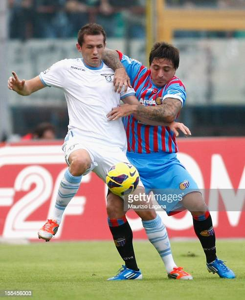 Pablo Alvarez of Catania competes for the ball with Senad Lulic of Lazio during the Serie A match between Calcio Catania and SS Lazio at Stadio...