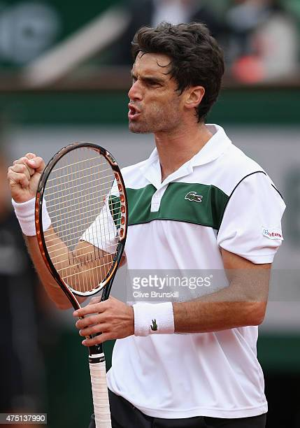 Pablo Andujar of Spain celebrates a point in his Men's Singles match against JoWilfried Tsonga of France on day six of the 2015 French Open at Roland...