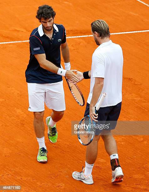 Pablo Andujar of Spain celebrates a point with Oliver Marach of Austria during a doubles final match between Jarko Nieminen / Andre Sa vs Pablo...