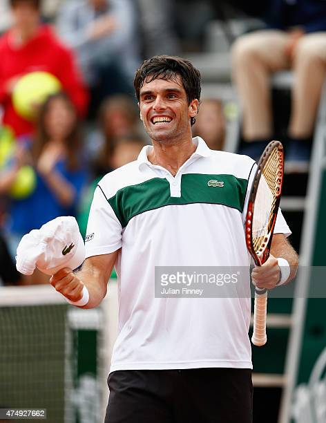 Pablo Andujar of Spain celebrates victory in his men's singles match against Philipp Kohlschreiber of Germany on day five of the 2015 French Open at...