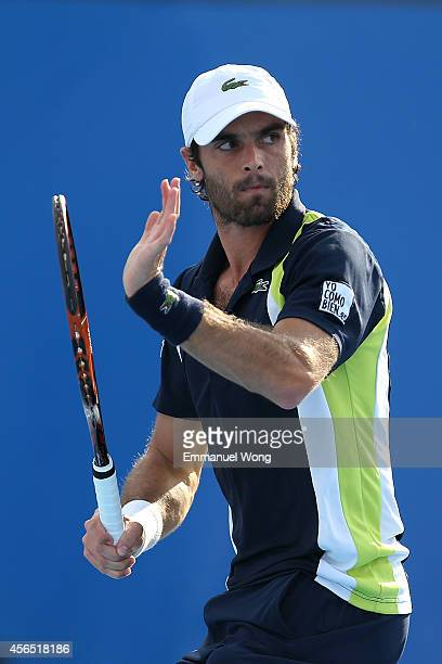 Pablo Andujar of Spain celebrates winning a point against Grigor Dimitrov of Bulgaria during day six of the China Open at the China National Tennis...