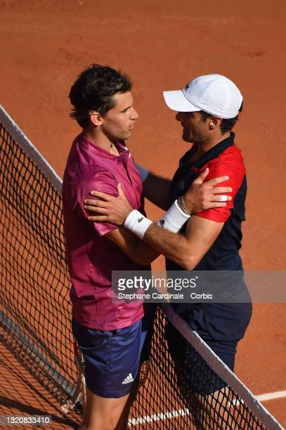 Pablo Andujar of Spain is congratulated at the net after his five set victory against Dominic Thiem of Austria in the first round of the Men's...