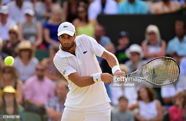 Pablo Andujar of Spain plays a backhand his Mens Singles Third Round match against Tomas Berdych of Czech Republic during day six of the Wimbledon...