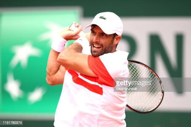 Pablo Andujar of Spain plays a backhand in his mens singles first round match against Matteo Berrettini of Italy during Day one of the 2019 French...