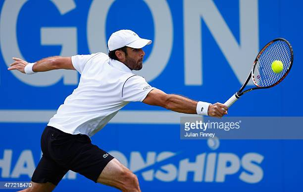 Pablo Andujar of Spain plays a backhand in his men's singles first round match against Guillermo GarciaLopez of Spain during day one of the Aegon...