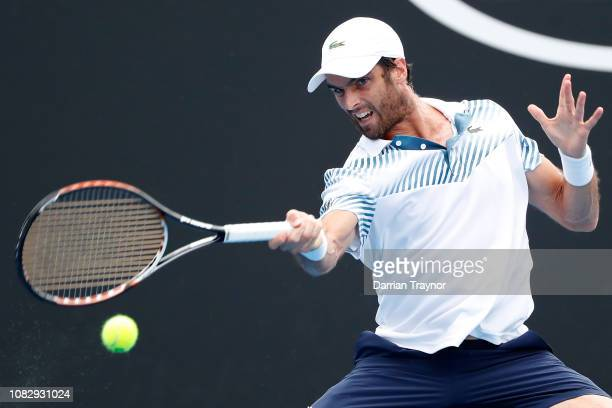 Pablo Andujar of Spain plays a forehand in his first round match against Denis Shapovalov of Canada during day two of the 2019 Australian Open at...