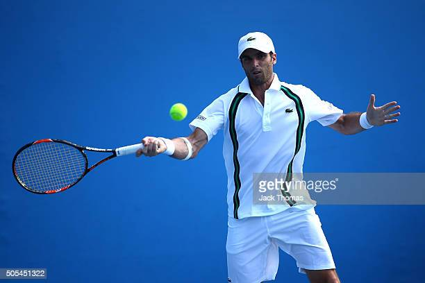 Pablo Andujar of Spain plays a forehand in his first round match against PierreHughes Herbert of France during day one of the 2016 Australian Open at...