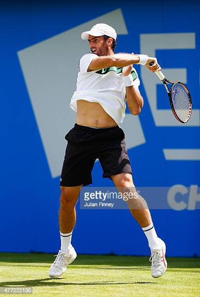 Pablo Andujar of Spain plays a forehand in his men's singles first round match against Guillermo GarciaLopez of Spain during day one of the Aegon...