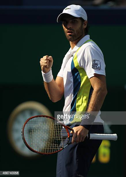 Pablo Andujar of Spain reacts during his match against John Isner of USA during the day 2 of the Shanghai Rolex Masters at the Qi Zhong Tennis Center...