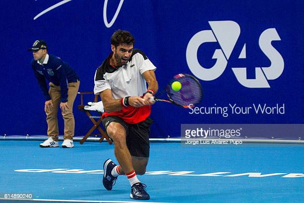 Pablo Andujar of Spain returns a shot against Kimmer Coppejans of Belgium during the Men's singles Qualification match in day One of the European...