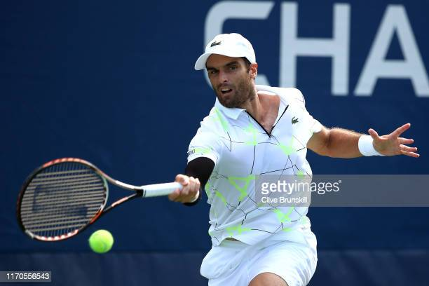 Pablo Andujar of Spain returns a shot against Kyle Edmund of Great Britain during their Men's Singles first round match on day two of the 2019 US...