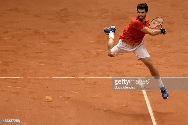 Pablo Andujar of Spain returns a shot against Thomaz Bellucci of Brazil during their playoff singles match on Day One of the Davis Cup at Ibirapuera...