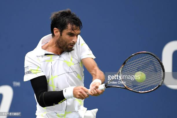 Pablo Andujar of Spain returns a shot during his Men's Singles fourth round match against Gael Monfils of France on day eight of the 2019 US Open at...