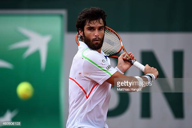 Pablo Andujar of Spain returns a shot during his men's singles match against Marin Cilic of Croatia on day two of the French Open at Roland Garros on...
