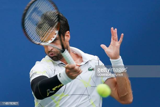 Pablo Andujar of Spain returns the ball against Gael Monfils of France in their Round Four Men's Singles tennis match during the 2019 US Open at the...