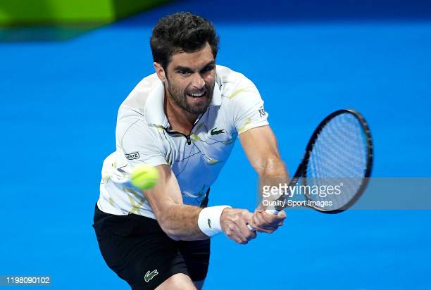 Pablo Andujar of Spain returns the ball in his mens singles first round match against Fernando Verdasco of Spain during day one of the ATP Qatar...