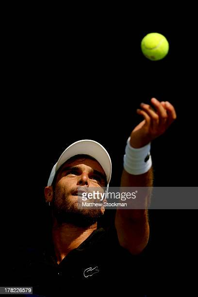 Pablo Andujar of Spain tosses the ball in the air to serve during his men's singles first round match against Thiemo De Bakker of Netherlands on Day...