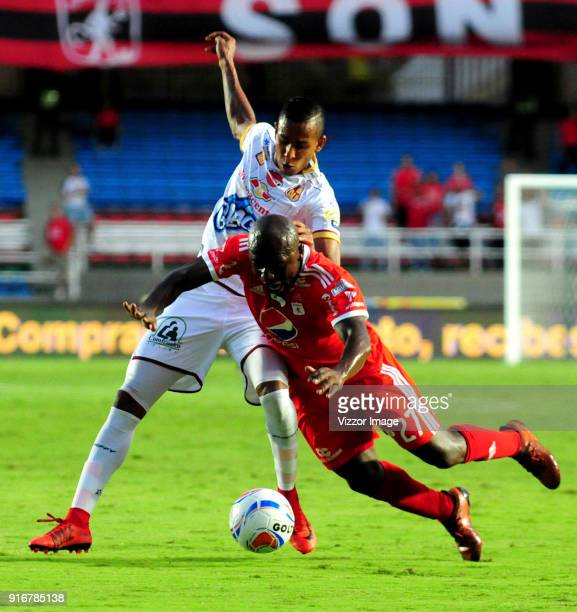 Pablo Armero of of America vies for the ball with Sebastian Villa of Deportes Tolima during a match between America de Cali and Deportes Tolima as...