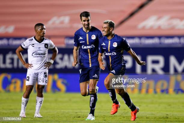 Pablo Barrera of Atletico San Luis celebrates after scoring the second goal with his teammate Matias Catalan during the 14th round match between...