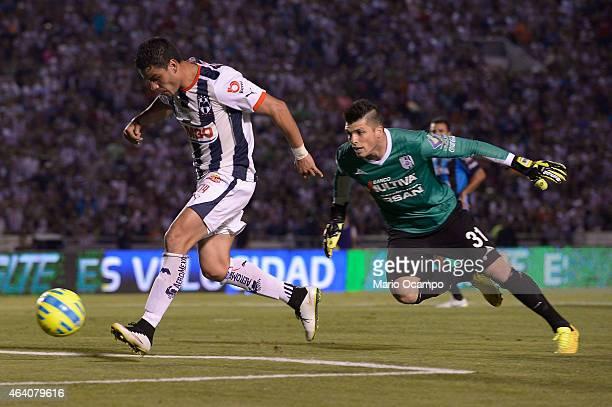 Pablo Barrera of Monterrey scores a goal over Tiago Volpi goalkeeper of Queretaro during a match between Monterrey and Queretaro as part of 7th round...