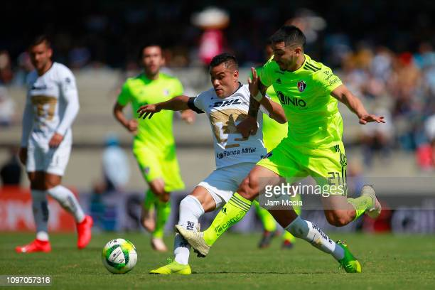 Pablo Barrera of Pumas and Edyairth Ortega of Atlas fight for the ball during the 3rd round match between Pumas UNAM and Atlas as part of the Torneo...