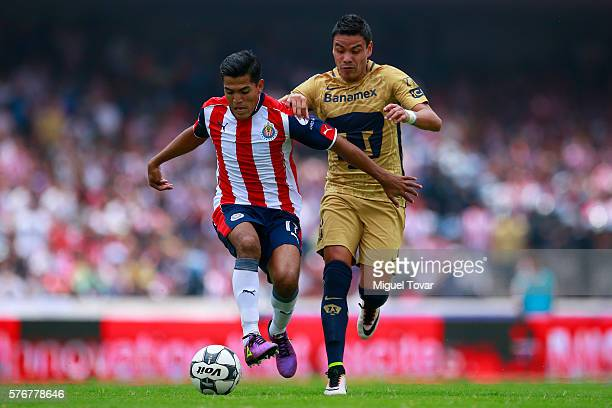 Pablo Barrera of Pumas fights for the ball with Jesus Sanchez of Chivas during the 1st round match between Pumas UNAM and Chivas as part of the...