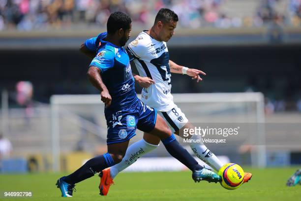 Pablo Barrera of Pumas struggles for the ball against Brayan Angulo of Puebla during the 15th round match between Pumas UNAM and Puebla as part of...
