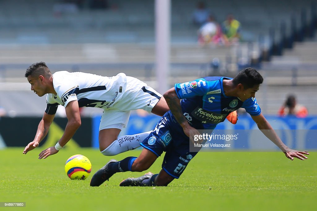 Pablo Barrera (L) of Pumas struggles for the ball against Jose Guerrero (R) of Puebla during the 15th round match between Pumas UNAM and Puebla as part of the Torneo Clausura 2018 Liga MX at Olimpico Universitario Stadium on April 15, 2018 in Mexico City, Mexico.