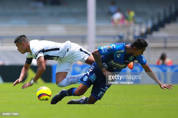 Pablo Barrera of Pumas struggles for the ball against Jose Guerrero of Puebla during the 15th round match between Pumas UNAM and Puebla as part of...