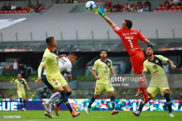 Pablo Barrera of Pumas struggles for the ball with Agustin Marchesin of America during the 7th round match between America and Pumas UNAM as part of...