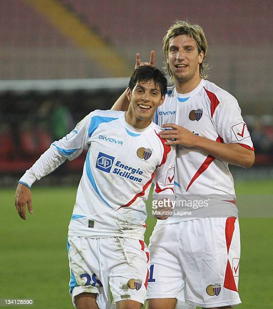 Pablo Barrientos and Maxi Lopez of Catania celebrate after the Serie A match between US Lecce and Catania Calcio at Stadio Via del Mare on November...
