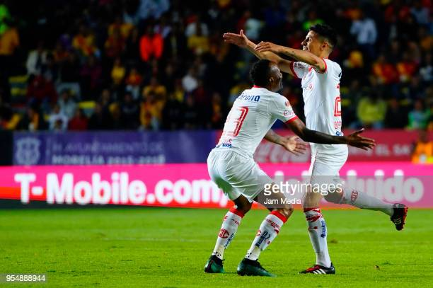 Pablo Barrientos of Toluca and teammate Luis Quiñones celebrate during the quarter finals first leg match between Morelia and Toluca as part of the...